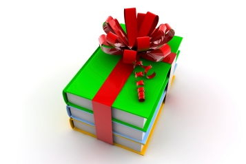 Three colored books with a ribbon like a present